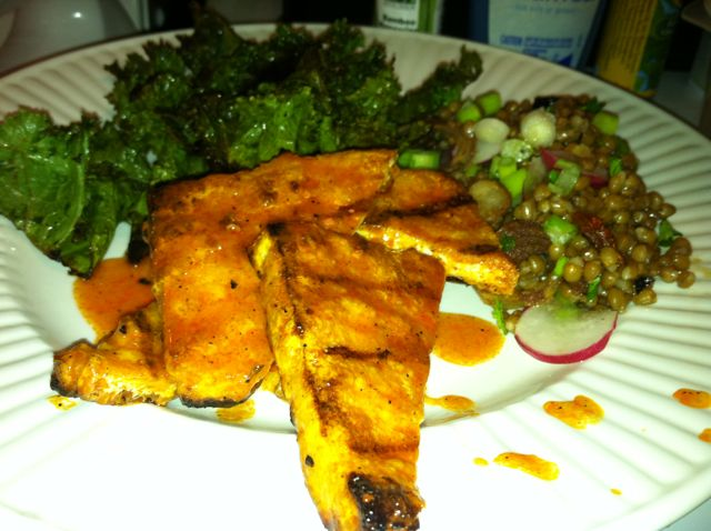 Grilled hot sauce glazed tofu, grilled kale, & wheat berry salad