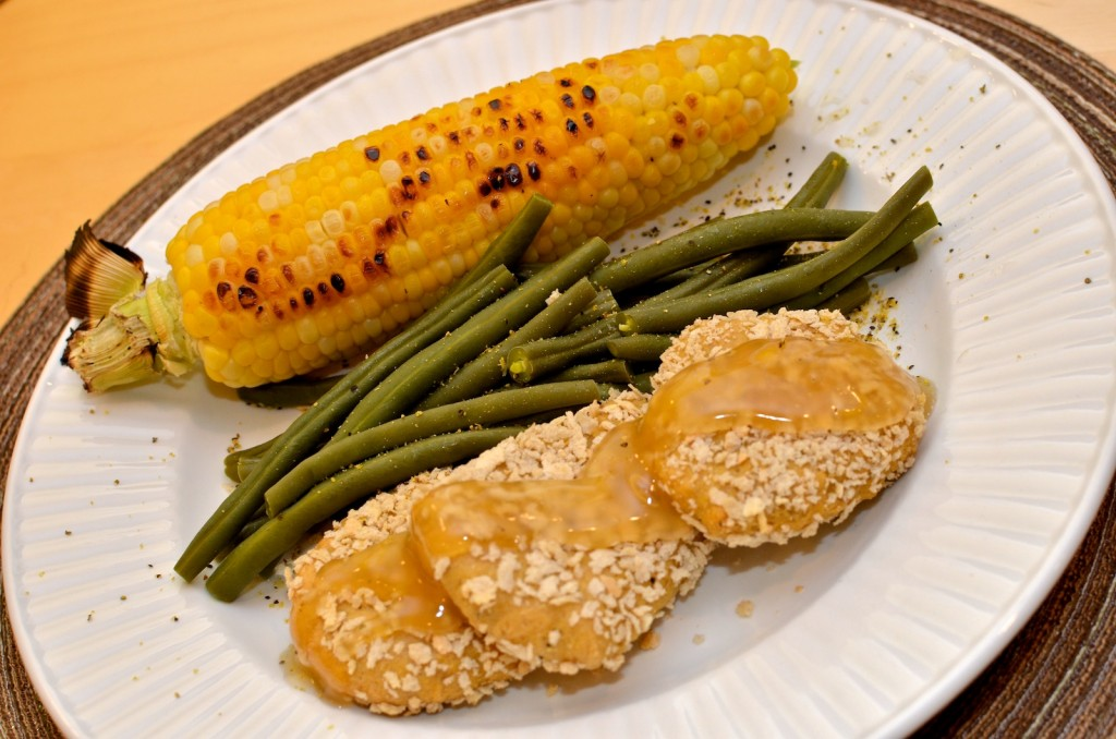 Grilled corn, lemon pepper green beans, and chickpea seitan patties with lemon sauce